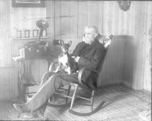 Uncle Finn enjoying the Victrola with his dog.