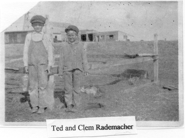 Ted and Clem Rademacher in front of their rabbit pen (photo from Paul and Kay Rademacher)