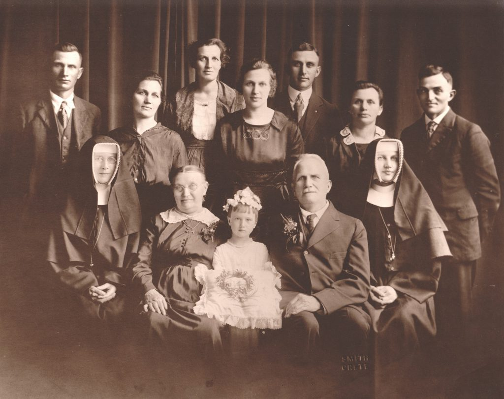 Front: Sr. Rocha, Josepha Rademacher, Josephine Willie, Joseph Rademacher, Sr. Elizabeth. Middle: Joe Rademacher, Helena Nave, Catherine Willie, Anna Hoesche, and Henry Rademacher. Back: Josephine Maas and Tony Rademacher